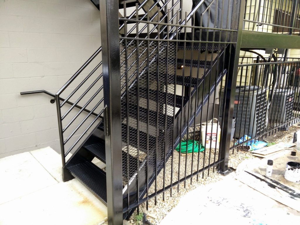 Metal stairs, wrought iron fence rust removal and refinishing. Chicago painter. West Town. Wicker park. West Loop. River North. Gold Coast. Lincoln Park